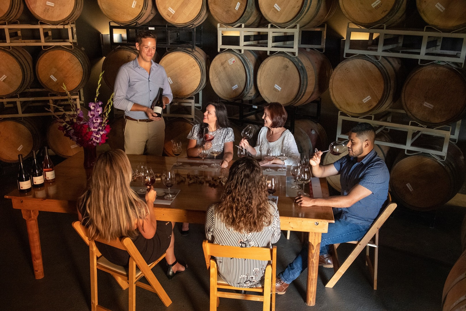 Seated-Tasting-in-Barrel-Cellar_Willamette-Valley-Vineyards_Photo-by-Andrea-Johnson.jpg